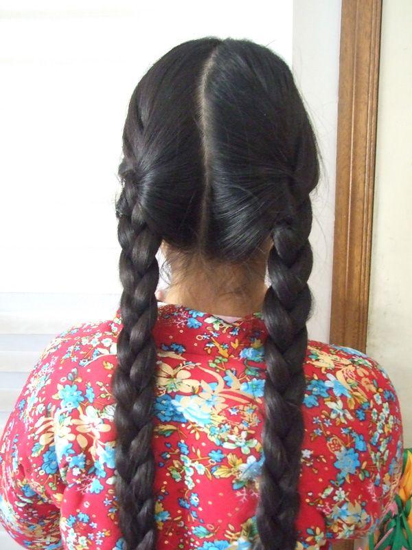 济南的11岁女孩的长双辫